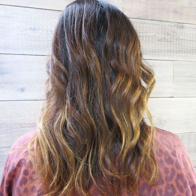 Loose, beachy curls make this sun-kissed color pop!_______________________________#instahair #instabeauty #atthesalon #salonlife #hair #hairspiration #hairsalon #haircolor #hairstyles #hairstyling #haircut #carlsbad #sandiego #sandiegohair #carlsbadhair #aveda #avedacolor #avedaproducts #avedaartist #smellslikeaveda #balayage #highlights #brunette #sunkissedhair