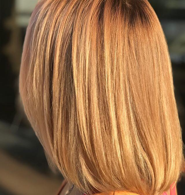 Check out this peachy, golden shine created by one of our talented Aveda Artists!